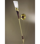Forme Design Long cone wall light that has drill & flame cut details